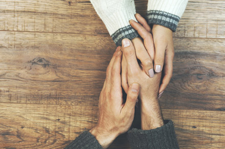 Two hands clasped