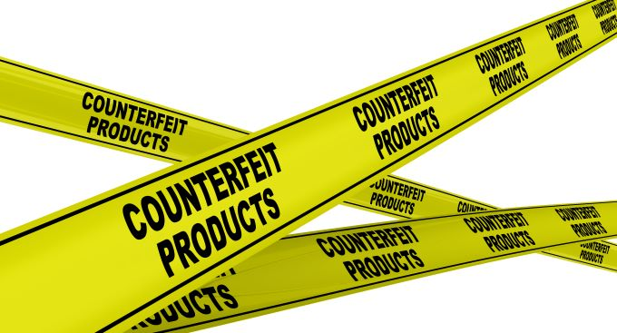 Yellow tape printed with word counterfeit