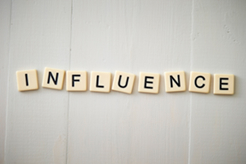 Letters spell the word influence.