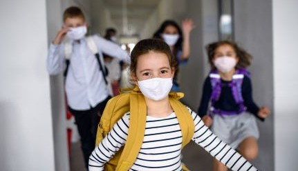 Masked pupils at school